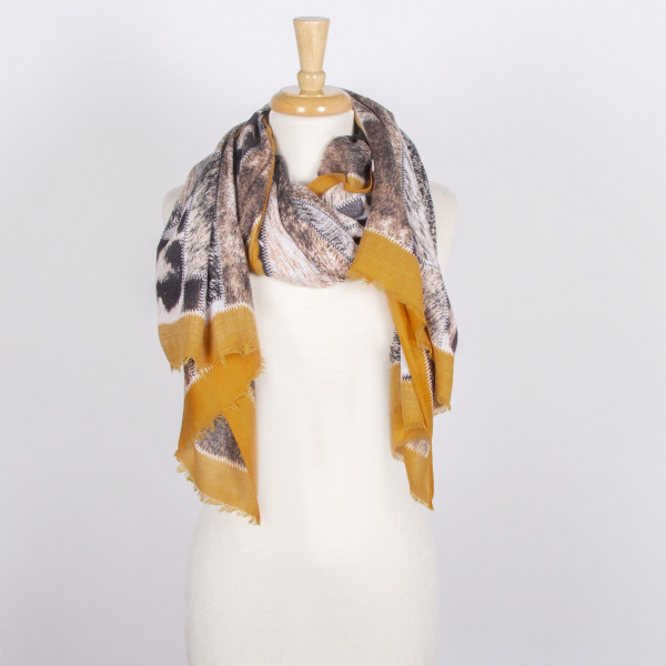 Lightweight animal print scarf. 100% viscose.
