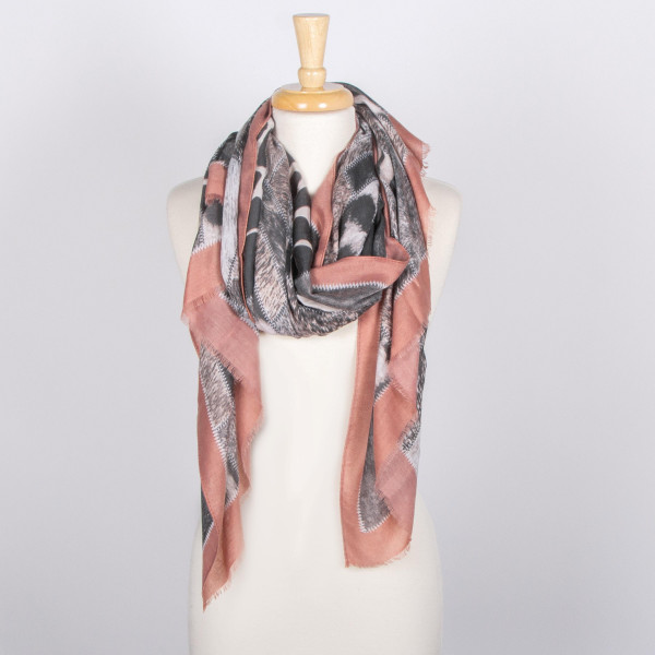 Lightweight animal print scarf. 100% viscose.
