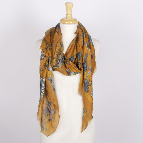Floral print scarf with solid color border. 100% viscose.