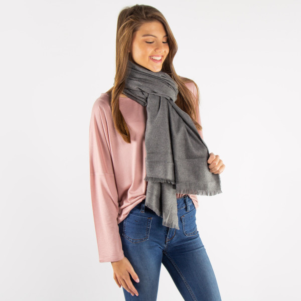Solid color scarf. 75% polyester and 25% viscose.