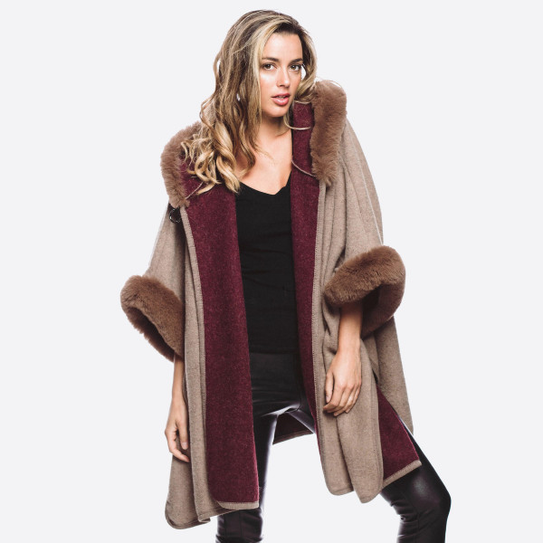 Long faux fur trim cardigan with hood and button neck closure. 100% acrylic.   One size fits most.