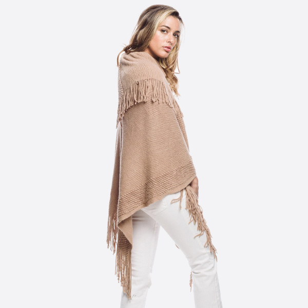 Stay warm with this cozy knit Poncho includes tassel ends.  •   Material: 100% Acrylic •   Size: 36''x40''