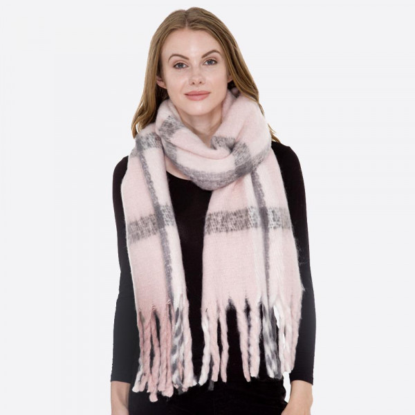 Soft touch plaid scarf with long fringe. 100% acrylic.