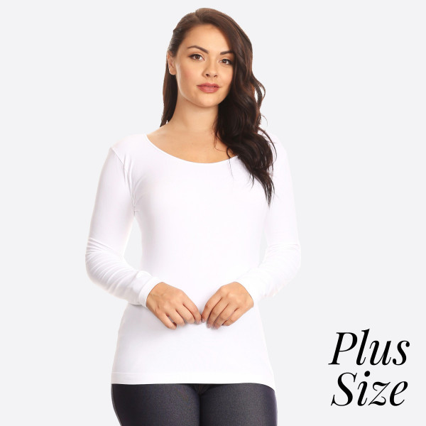 This Seamless Long Sleeve Top is perfect to layer or wear on its own.   • Seamless knit top  • Scoop neckline  • Long sleeves  • Seamless finish  • Silk satin edging lies flat against skin  • Fitted silhouette  • Pullover style.   Composition: 92% Nylon, 8% Spandex