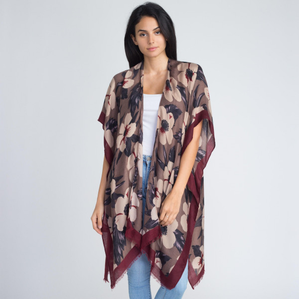 Floral print kimono. 100% polyester.   One size fits most.