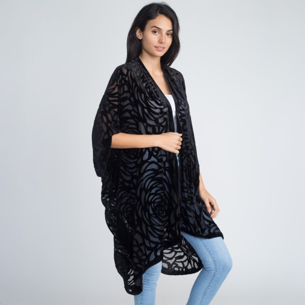 Crushed velvet animal print kimono. 100% polyester.   One size fits most.