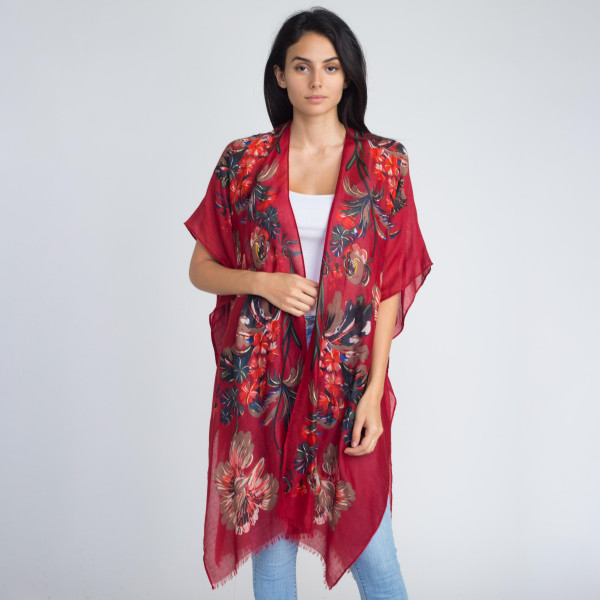 Floral print kimono with metallic detail. 100% viscose. One size fits most.