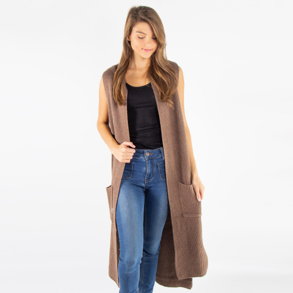 Long cozy sleeveless kinit vest with front pockets.100% acrylic.