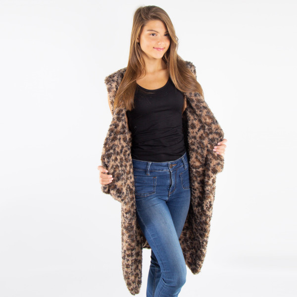Sleeveless soft touch faux sherpa -leopard print vest. 100% acrylic.   One size fits most.