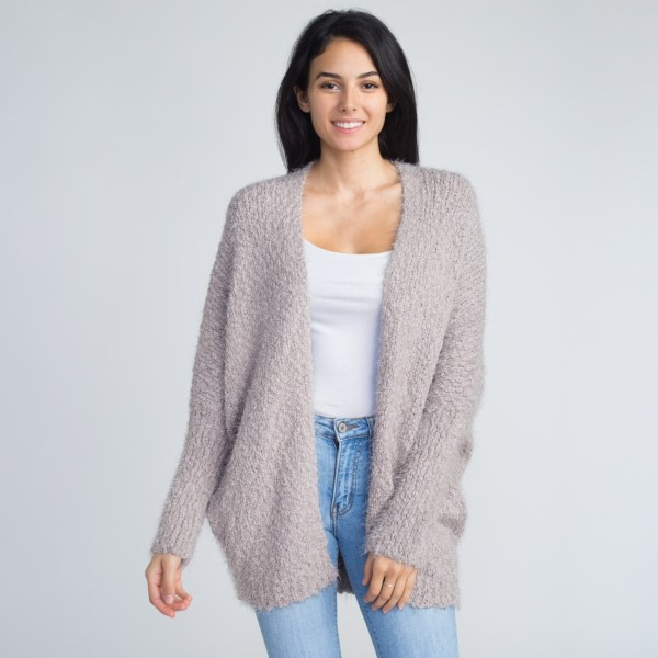 Soft knit cardigan. 55% acrylic and 45% cotton.   One size fits most.