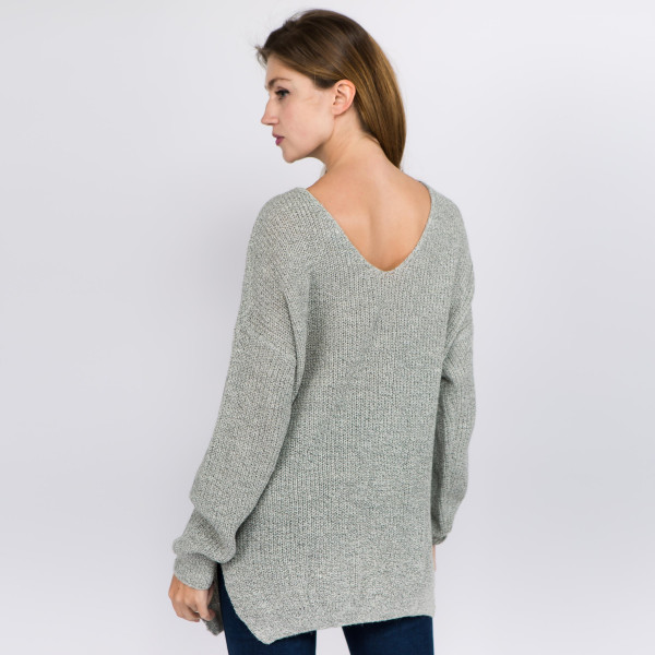 "Fuzzy heather knit criss cross v neck sweater with side slit details.  - One size fits most 0-14 - Approximately 22"" in length - 72% Acrylic, 20% Nylon, 8% Polyester"