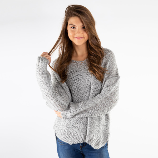 Soft long sleeve knit sweater. Made with 55% acrylic and 45% cotton. One size. S-L.