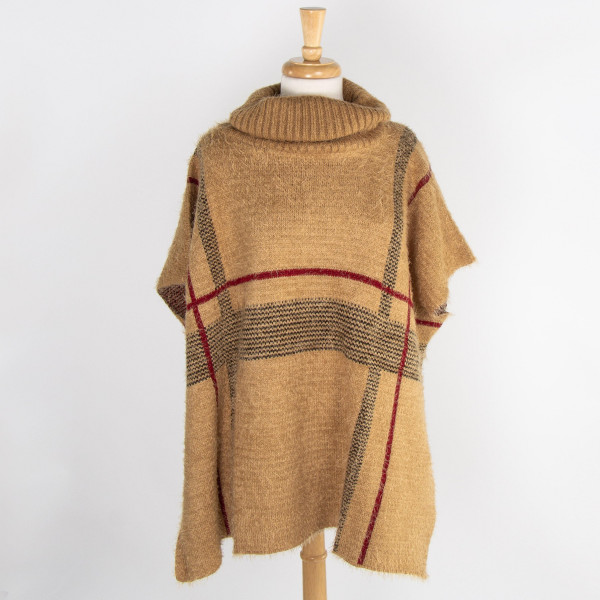 Turtle neck knit poncho. 100% acrylic. One size fits most.