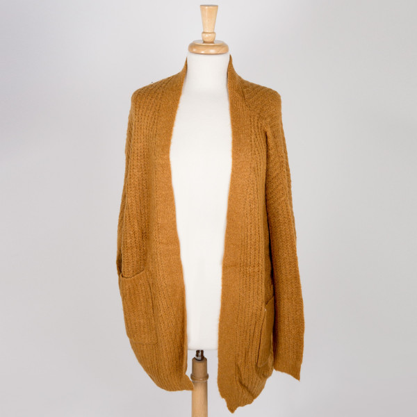 Gorgeous knit like cardigan with front pockets. 55% Acrylic 45% cotton
