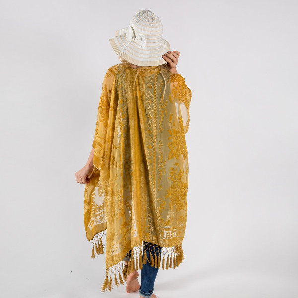 """Gold floral kimono with tassels. One size fits most 0-14. Measures approximately 42"""" x 36"""" in size. 50% Viscose, 50% Nylon."""