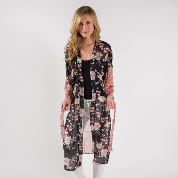 """Pink floral printed kimono with waist tie closure. Measures approximately 45"""" in length. One size fits most 0-14. 100% polyester."""