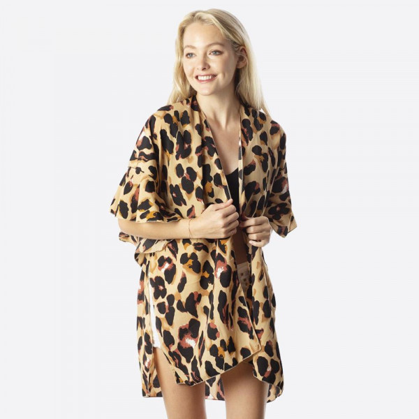 Leopard print kimono with ruffles.  100% polyester.