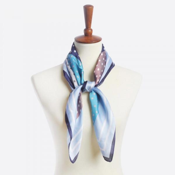 Polka dot print scarf. 100% polyester.