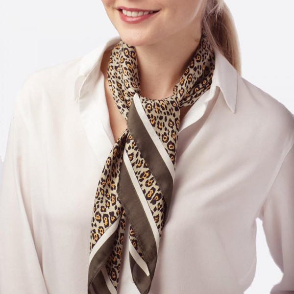 Lightweight leopard scarf with black border. 100% polyester.