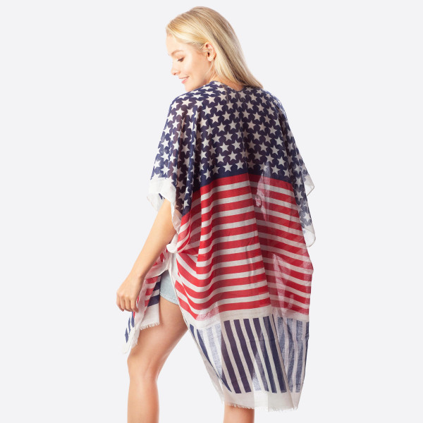 "Women' lightweight stars and stripes kimono.  - One size fits most 0-14 - Approximately 37"" L - 30% Cotton, 70% Polyester"