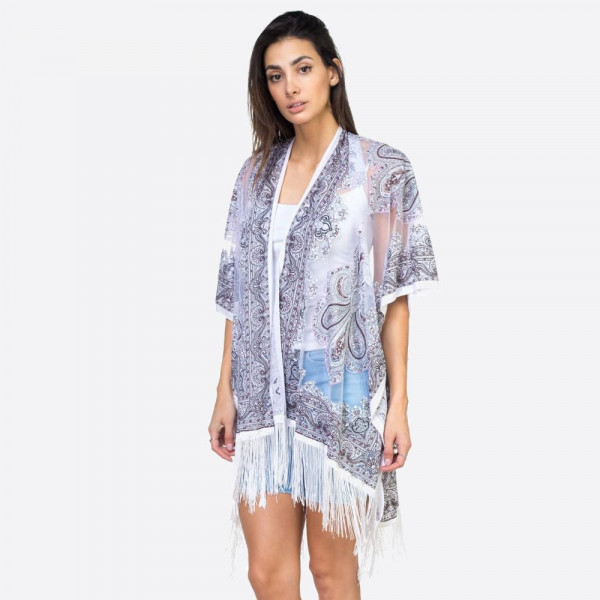 """White mandala sheer kimono with fringes. 39"""" x 29"""" in size. One size fits most 0-14. 60% polyester 40% viscose."""