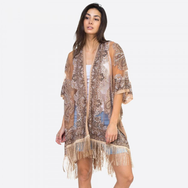 """Taupe mandala sheer kimono with fringes. 39"""" x 29"""" in size. One size fits most 0-14. 60% polyester 40% viscose."""
