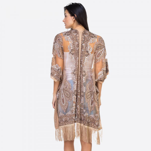 "Taupe mandala sheer kimono with fringes. 39"" x 29"" in size. One size fits most 0-14. 60% polyester 40% viscose."
