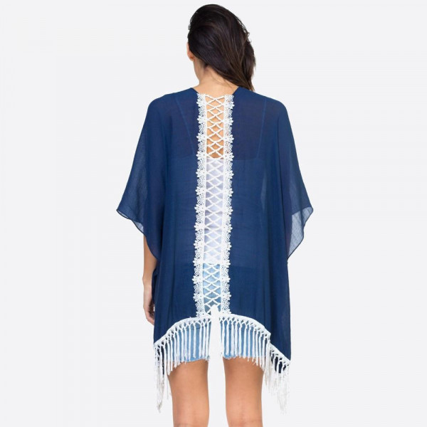 "Solid navy blue kimono with lace down the back and fringe detailing. One size fits most 0-14. Measures approximately 37"" x 27"" in size. 65% Polyester, 35% Cotton."