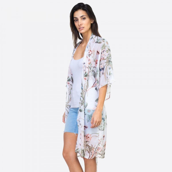 "White lightweight floral print kimono with waist tie. One size fits most 0-14. Measures approximately 30"" x 39"" in size. 100% polyester."