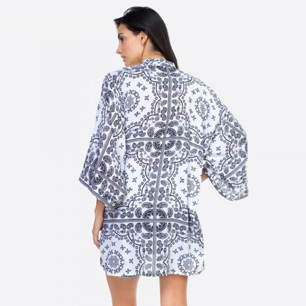 """White paisley geometric kimono. One size fits most 0-14. Measures approximately 25""""x 36"""" in size. 100% Viscose."""