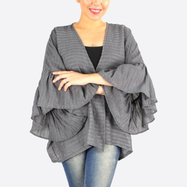 Solid color ruffle sleeves kimono. 55% cotton- 45% viscose.