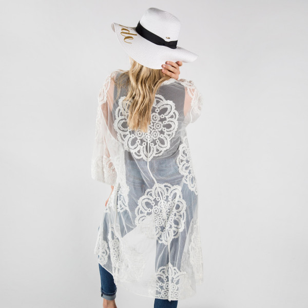 Lightweight white lace kimono with waist tie. One size fits most 0-14. 50% cotton-50% polyester.