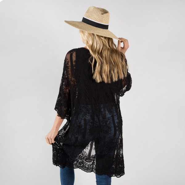 Light weight lace kimono. 50% cotton-50% polyester.  Fits most 0-14.