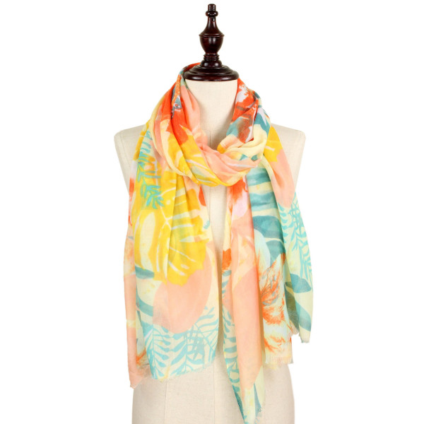 Soft tropical print scarf. 100% polyester.