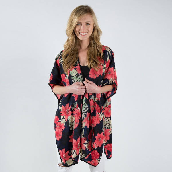 Navy blue kimono with tropical flowers. One size fits most 0-14. 100% polyester.