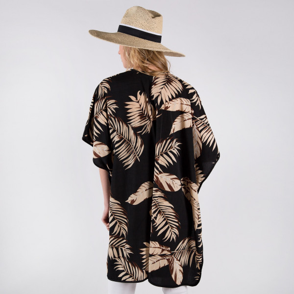 Black kimono with tan palm tree leaves. One size fits most 0-14. 100% polyester.