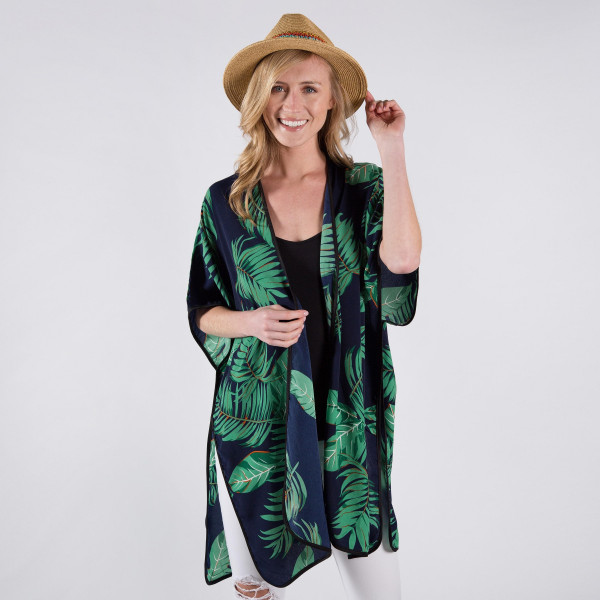 Navy blue kimono with palm tree leaves. One size fits most 0-14. 100% polyester.