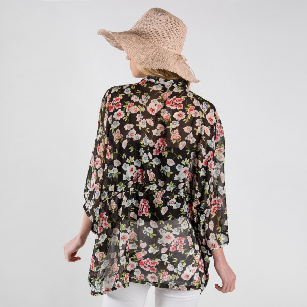 Light weight floral kimono with waist string tie. 100% polyester.