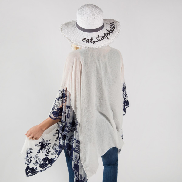 Floral lace kimono. 20% Cotton, 80% Polyester. One size fits most 0-14.