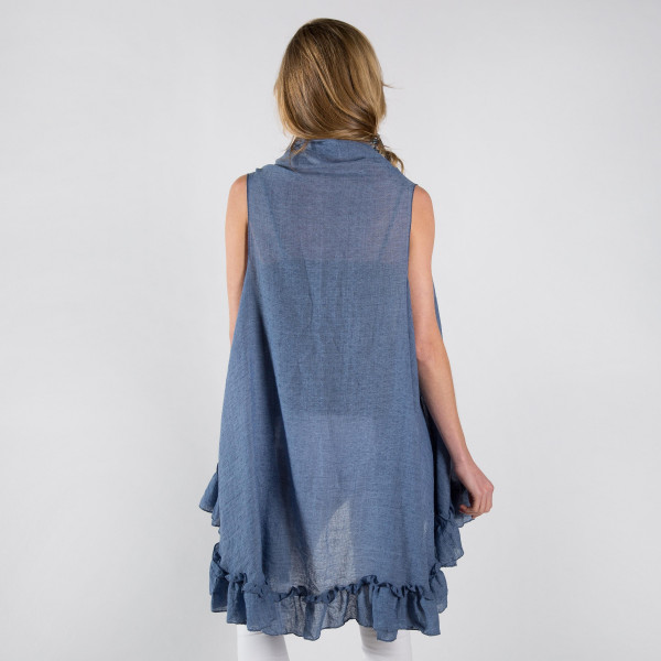 Cotton blend ruffle vest. 20% cotton - 80% polyester.