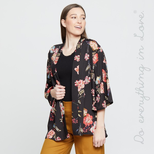 Lightweight, short sleeve kimono with a floral print. 100% polyester. One size fits most 0-14.
