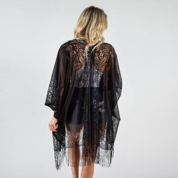 Light weight laced kimono with fringes. 100% viscose.