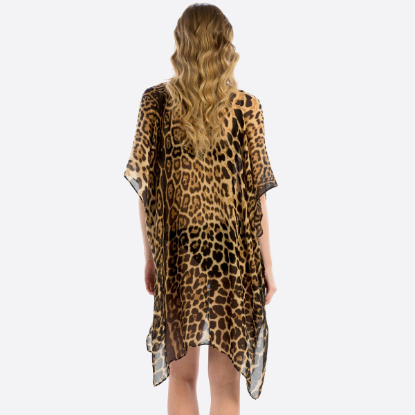 Animal print shawl cover up.  100% polyester. 35.4x71 in length.