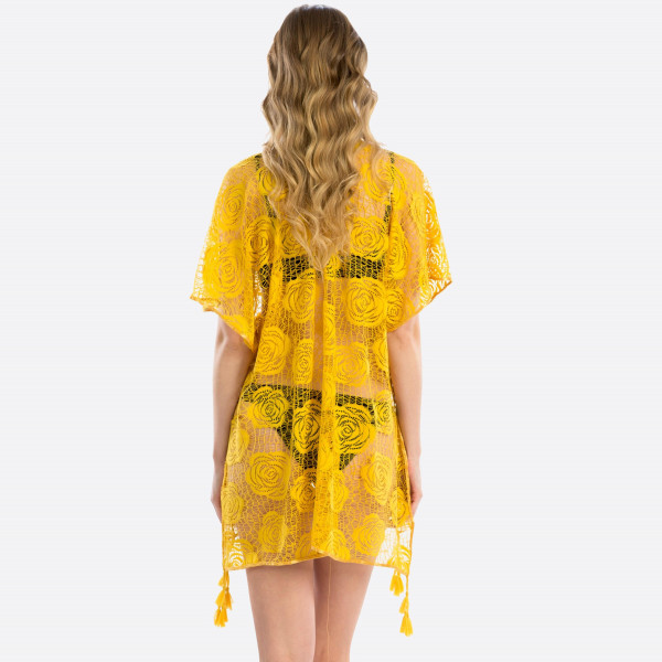 Light weight sheer rose pattern cover up with tassels . 100% polyester.  31.4X63. Fits most 0-14.