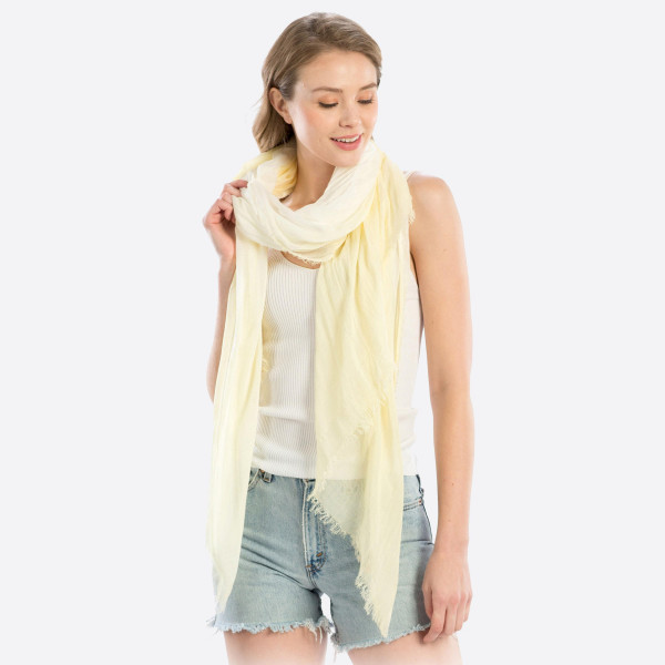 "Lightweight yellow hombre scarf. Measures approximately 40"" x 74"" in length. 100% Modal."