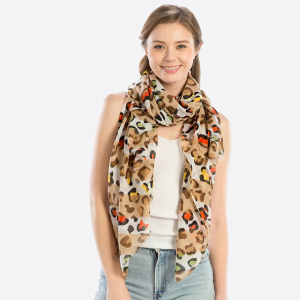 "Lightweight cheetah print scarf. 100% polyester. 70""x 20"" In length."
