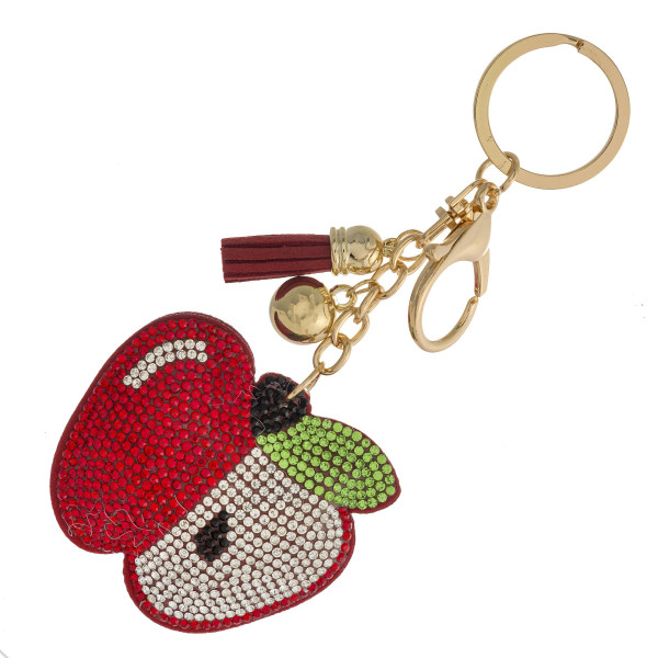 "Apple keychain holder featuring rhinestone details and a tassel accent. Apple approximately 2"" in diameter."