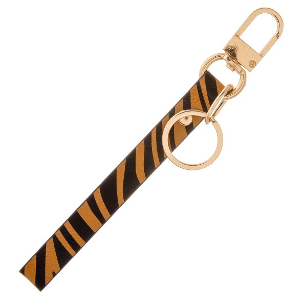 "Faux leather zebra print keychain holder wristlet.  - Approximately 7"" in length"