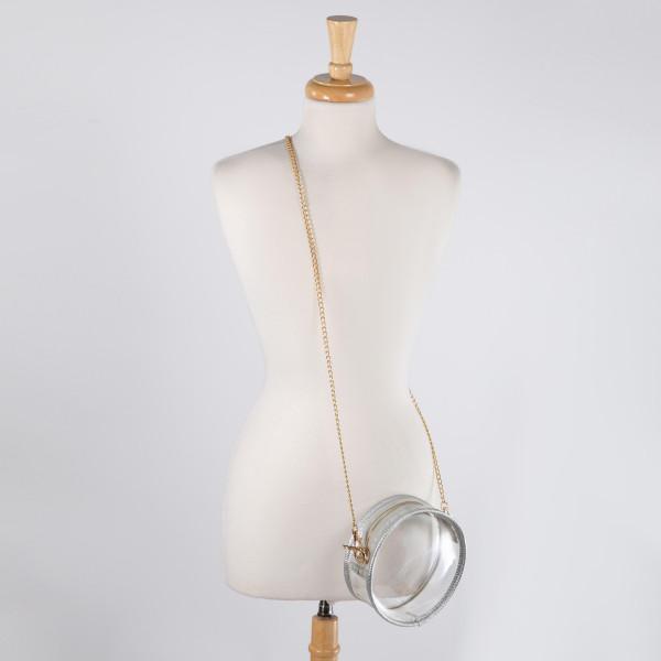 "Clear cross body hand bag. 7"" diameter."