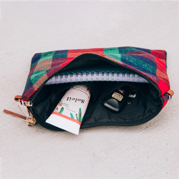 "Plaid crossbody/clutch bag featuring a lined inside pocket detail with a zipper closure.  - Approximately 11"" W x 8.5"" H - 100% Polyester"